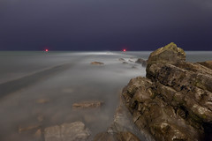 Seastate (Peverill Point & Rain), Swanage (flatworldsedge) Tags: longexposure red sea water rain night point lights rocks waves state tide dorset oil submerged swanage