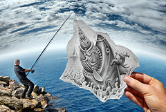 Pencil Vs Camera - 59 (Ben Heine) Tags: ocean blue sea sky art breakfast danger composition dinner wow paper lunch photography drive graphicdesign shark sketch seaside scary fisherman rocks hand arte tunisia drawing mixedmedia surrealism magic details horizon main workinprogress attack creative wave hobby dessin eat illusion caricature reality imagination parody requin splash capitalism predator metaphor dimension vague poisson dibujo papier foodchain crocs magie fisheyelens waterscape vulnerable smallboat blackhumor misee