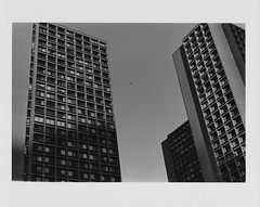 The Silver Towers (The Frotographer) Tags: sky bw film contrast 35mm kodak trix helicopter oriental vivitar greenwichvillage silvertowers sooc