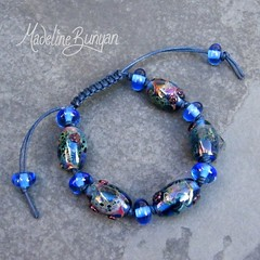 "Denim Blue & shard Beads Lampwork Bead Bracelet on cord • <a style=""font-size:0.8em;"" href=""https://www.flickr.com/photos/37516896@N05/6499725493/"" target=""_blank"">View on Flickr</a>"