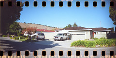 Sprocket Street (earthdog) Tags: road street travel vacation film car 35mm lomo lomography toycamera salinas sprocket 2011 sprocketrocket