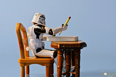 TK-459 sits down to write his letter to Santa (louisa827) Tags: blue pencil writing notebook table toy toys starwars chair stormtroopers actionfigures stormtrooper hasbro plastictoys