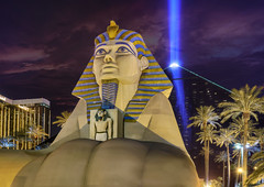 Luxor Las Vegas at Night - Sphinx and Beam (Mister Joe) Tags: winter desert tourist resort thestrip placesofinterest d7000 architectureandstructures lasvegasnvusanevadaluxorpyramidsphinxnightdynamicrangehdrlightbeampalmtreescasinojoeegyptianhotelbeaconglowingnikon