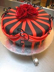 Single tier Mad Hatter cake covered in black fondant decorated with red stripes, drapes, black wire twirlies & 3 fresh red roses (Charly's Bakery) Tags: birthday cake 40th town tv chocolate formal wicked angels bakery reality cape 50th burlesque charlys june2010