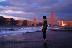 Golden Gate Bridge (NatVon Photography) Tags: sanfrancisco sunset beach girl clouds sand goldengatebridge barefoot