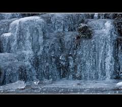Frozen cascade (Martyn.Smith.) Tags: winter snow ice wales canon eos flickr december wasserfall cymru frosty breconbeacons waterfalls valley cascade cachoeira icicles 2010 subzero cascada cascata pontneddfechan frozenwaterfall waterval ystradfellte 450d
