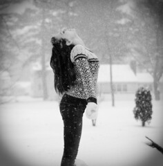 the commencement of a new beginning (meg.reilly) Tags: portrait blackandwhite bw selfportrait snow girl smile yard self happy snowflakes 50mm sweater nikon d70 nikond70 snowstorm portraiture fairisle brunette blizzard vignette mittens newbeginnings nikkor50mm