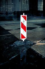 HALT! (andersdenkend) Tags: red white church wet sign stone contrast warning dark bright dom cologne stop alert halt defocus floow nikkor50mmf12 nikond700