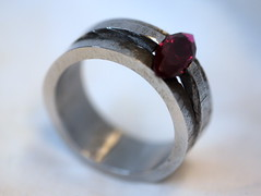 Iron and Ruby Ring (the justified sinner) Tags: justifiedsinner jewellery jewelry iron ruby gaspipe found object corundum ring tensionset panasonic leica elmarit macro 28 45mm