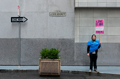 Give us our families back (Brandon Doran) Tags: sanfrancisco california ca rain alley protest financialdistrict rainy wellsfargo sfist 99percent fidi osf leidesdorff occupy occupysf occupywallstreetwest owswest 20120120dsc8290edit