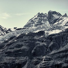 Under The Mountain (Christopher DiNottia) Tags: light wild sky cliff mountain color art ice nature ecology colors rock stone alaska canon outside outdoors interesting intense scenery mood peace view good earth country hill environmental peak scene boulder glacier ridge mount explore valley surprise summit vista environment remote tall wilderness range powerful eco crevasse frontier precipice exciting amaze crag godly tallness quiteng