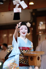 The maiko (geisha apprentice) Ichiwaka /   / Kyoto, Japan (momoyama) Tags: travel blue winter portrait people woman flower girl beautiful beauty smile face festival japan canon outdoors japanese photo dance costume beans kyoto shrine asia traditional culture makeup 85mm lips maiko geiko geisha 7d kimono throwing ef85mmf18