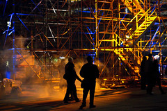 Nuit Blanche 2011 - Scaffolds (tamjty) Tags: street city blue light people toronto canada man art silhouette yellow canon photography eos 50mm lights downtown colours f14 candid streetphotography sigma 7d cinematic lasershow nuitblanche torontocityhall scaffolds nathanphilipssquare 2011