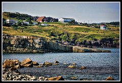 Sea side town ~ Flatrock NL (Nancy Hawkins) Tags: ocean blue rural newfoundland rocky sloping flatrock hiils