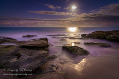 Down goes the full moon... (Mccamli) Tags: sea moon clouds dawn islands rocks waves australia bluehour milky westernaustralia moonset naturesgallery