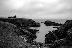 Slains castle (Dracula legend) ruins loom over a dark cross bay, Aberdeenshire, Scotland (grumpybaldprof) Tags: sea sky bw black building castle monochrome rock architecture grey bay scotland ruins waves mood moody aberdeenshire vampire towers scottish atmosphere cliffs dracula pile granite walls stillwater legend fortress hdr atmospheric ruined smugglers bowness slains calmseas collieston baronial blackwhite northsea darkcliffs bramstoker slainscastle newslainscastle crudenbay earloferrol kingjamesvi clanhay