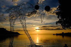 Bird of a Wire? (spcoonley) Tags: sunset sculpture lake bird switzerland wire fuji geneva fujifilm montreux xe2 xf23mmf14