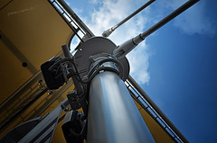fermo al palo (pamo67) Tags: blue sky yellow pillar headlights giallo cielo sail coverage vela rho fari fromunder pilastro copertura dasotto expo2015 pamo67 pasqualemozzillo stuckatthepole particularlythedecumanus