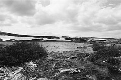 The Big Empty (IggyRox) Tags: sky blackandwhite lake mountains film nature water norway clouds 35mm flow norge europe north hike rough scandinavia rondane outflow oppland rondanenationalpark gravbekken storrvatnet