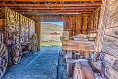 Bodie Wagons in the Barn_HDR_7983_84_85 (www.karltonhuberphotography.com) Tags: wood history texture barn interior exploring historic highdesert bodie hdr oldbuilding woodenbuilding harsh goldrush wagons woodenstructure wagonwheels miningtown historicsite landscapephotography offthebeatenpath bodiestatepark ruggedcountry wildplaces easternsierrafoothills