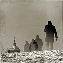 No Religion (una cierta mirada) Tags: winter snow man black tower church walking square interestingness explore textured 38 meco on 20111125 38ininterestingnesson20111125 24ininterestingnesson20111125