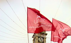 Red Flags Over Brighton (brightondj) Tags: uk clock march brighton protest clocktower demonstration christmasdecorations strike unions n30 tradeunions xmasdecorations november30thstrike