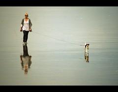 Mirror walking (bkiwik) Tags: newzealand woman dog pet reflection beach lady digital canon walking person mirror walk shoreline reflected reflect shore simplicity nz mirrored leash dslr simple stroll aotearoa minimalistic k9 dogwalking reflects strolling newbrightonbeach walkingthedog simplistic mimimal eos400d
