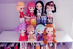 dolls on books