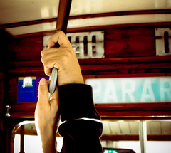 hold on (f T H R) Tags: portugal holding hands couple lisbon streetcar parar elctrico28