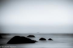 Out there. (Elizabeth Haslam) Tags: ocean california blue sunset sea seascape water monochrome rock rocks soft earth highway1 tired sansimeon morrobay centralcoast cambria morrorock skywater sealine 2011 highway46 nlwirth joeljintjelaar