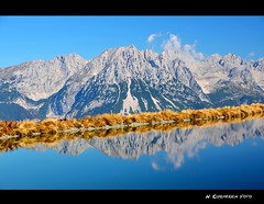 der Tanz im See (H. Eisenreich Foto) Tags: blue sky lake mountains alps reflection clouds prime austria see tirol photo ic foto fotografie image hans award himmel wolken going berge heike getty alm kaiser alpen blau landschaft alpi spiegelung tyrol wilder reise gettyimage 2011 ellmau reisefotografie poststrasse landschaftsfotografie schmidmhlen kaisergebirge hartkaiser eisenreich reisefoto tanzbodensee tanzbodenalm eijomian landschftsfoto