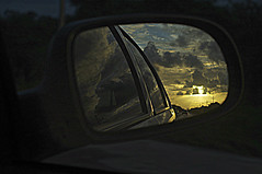 leaving all behind. (Fabian Jurado.) Tags: road sunset sun reflection leave sol car yellow clouds amarillo nubes reflejo past carreflection letgo sundawn dejar forgivness dejando olvidar sunsetontheroad