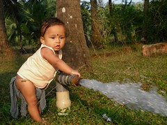 shrida (Ganesh @bantakal.com) Tags: boy plants baby india playing tree water field lumix kid child play panasonic karnataka loincloth kovanam langoti langot dmcf3 shrida koupeenamm