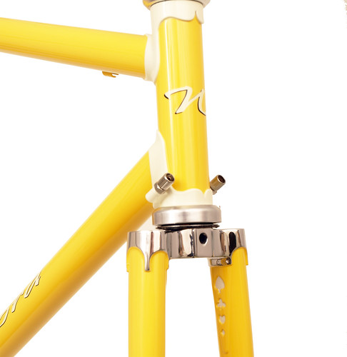 <p>22-Series Artisan Design with Sachs Richissimo Lugs.  Head tube view with stainless fork crown and painted windows.  Canary with Vanilla Shake head lugs and trim.  62535</p>