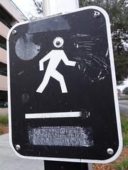 Cyclops Crossing (xvm) Tags: sign pedestrian vandalism crosswalk signal usf googlyeye