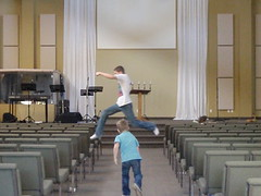 Leaping into Thursday .... (Mr. Happy Face - Peace :)) Tags: play jump church chair action service composition perspective youth group fun funny playful exciting unsupervised challenge dare teens youthgroup hope alberta canada legs children hallway seating wtbw bench hbm benchmonday happybenchmonday yyc flickrfriends