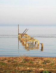 The Jetty (Louise and Colin) Tags: old uk pink blue england english beach water wooden still britain jetty norfolk pebbles calm estuary explore shore naturereserve british serene snettisham rspb birdreserve thewash explored highspringtide veryhightide hightidewaderspectacular