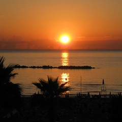 sunrise (SS) Tags: city light shadow red sea summer vacation italy orange brown sun seascape water weather silhouette june yellow clouds composition contrast umbrella canon landscape photography sand colorful soft barca mare waves mood glow glare shadows dof view pov walk perspective scenic silhouettes powershot burning shade crop framing lungomare nero depth tone foreshore abruzzo breakwater atmophere natureselegantshots a480