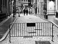Carless Street (John Fraissinet) Tags: street nyc newyorkcity ny newyork men duo streetphotography cobblestone barrier stonestreet