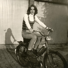 Teenager on Motorbike (Batikart) Tags: light shadow portrait bw lamp smile face wheel proud vintage germany square