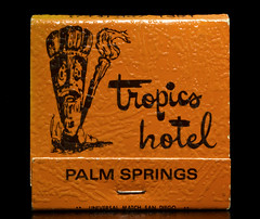 Tropics Hotel (Curtis Gregory Perry) Tags: california orange black texture dark fire hotel nikon 60s san fifties background diego palm retro springs tropical match tropic 50s universal matches tiki tropics sixties matchbook d300