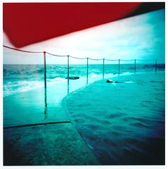 Bronte float (Aliceblueblazes) Tags: beach holga xpro sydney australia crossprocessing nsw bronte oceanbath oceanpool