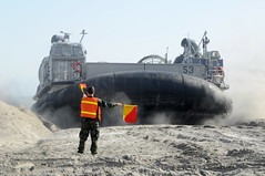 A Sailor directs a landing craft air cushion during Bold Alligator 2012. (Official U.S. Navy Imagery) Tags: nc unitedstates camplejeune boldalligator2012 wwwfacebookcomusnavy