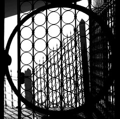 La porta era aperta (meghimeg(temporarily disconnected)) Tags: door shadow bw sun corner fence circle square ombra ring round porta sole lavagna biancoenero 2012 cerchio inferriata angolo cancellata quadrata