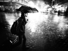 Pike rush (sparth) Tags: seattle bw monochrome rain umbrella walking mono blackwhite washington downtown rainy wa pike washingtonstate ricoh pikestreet noirblanc pikemarket 2011 seattledowntown grd ricohgrdiv grdiv