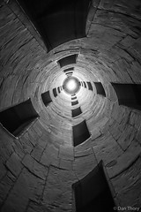 Double Helix (Dan Thory) Tags: travel light blackandwhite abstract building architecture perspective tunnel column lightattheendofthetunnel
