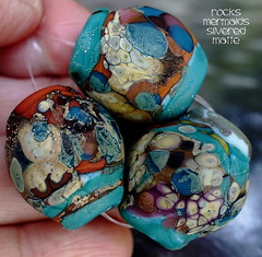 Rocks Mermaids Silvered Matte (Laura Blanck Openstudio) Tags: show blue roof red etched usa brown abstract brick green art glass festival set silver tile beads leaf big sand beige rocks colorful artist glow purple handmade eggplant teal maroon fine arts almond violet lavender plum sienna funky jewelry pebbles made odd caramel lilac honey earthy copper opaque bead organic mermaid kiln nuggets murano lampwork multicolor raku artisan matte whimsical loose frosted frit openstudio asymmetric ocher speckles tumbled silvered annealed openstudiobeads