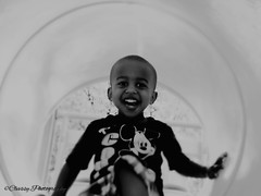 Capturing The Joy 1 (ClvvssyPhotography) Tags: park family blackandwhite smile laughing fun outdoors person photography kid drew slide nephew capture clvvssyphotography