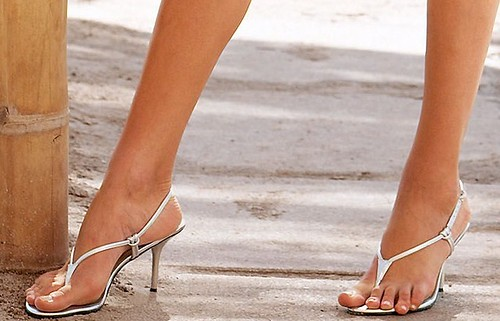 Sexy feet in high heel thong sandals more than