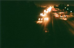 Drivin' down your freeways, Midnight alleys roam (Taylor F.) Tags: cars film night 35mm lights la losangeles highway focus minolta nighttime longbeach freeway dreamlike thedoors lawoman